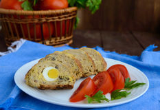 Meatloaf with mushrooms and boiled egg. Close up. Royalty Free Stock Photo