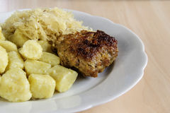Beef and pork patties. Meatloaf with potato dumplings and cabbage Royalty Free Stock Images