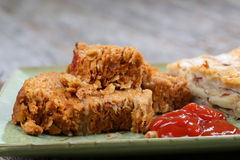 Meatloaf and potatoes. A few slices of turkey meatloaf, ketchup and cheese potatoes Royalty Free Stock Images