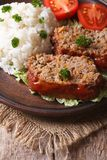 Meatloaf with rice and vegetables on a plate closeup, vertical Royalty Free Stock Photo