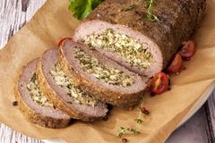 Meatloaf stuffed with eggs stock images
