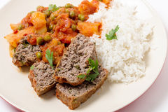 Meatloaf with tomato sauce and rice Stock Images