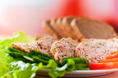 Meatloaf with vegetables on Royalty Free Stock Photos