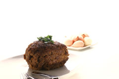 Meatloaf on a white plate. With fork and knife Royalty Free Stock Images
