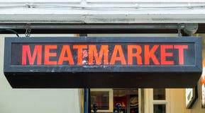 Meatmarket Sign. Illumintated Meatmarket Sign Above Doorway Stock Photos