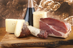 Meats and cheeses with white wine Royalty Free Stock Images