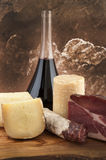 Meats and cheeses with white wine Stock Photography