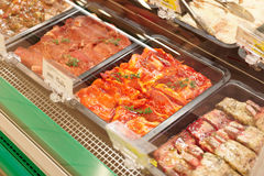 Meats in marinade on supermakket display Stock Images