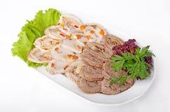 Meats på en maträtt Arkivfoto