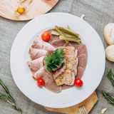 Meats. The pieces of meat on a porcelain plate menu Stock Image