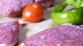 Beef steaks, ground meat on cutting board and counter top. stock footage