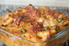 Meaty baked rigatoni in an  oven pan of glass Royalty Free Stock Photography