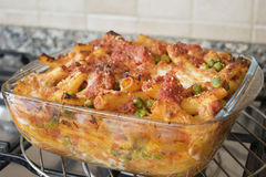 Meaty baked rigatoni in an  oven pan of glass Stock Photo