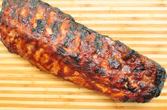 Meaty pork ribs smothered with bbq sauce Stock Image