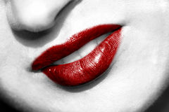 Meaty red lips. Meaty red coloured lips over a white and black face Stock Photo