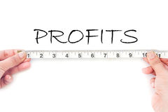 Meausuring profits. Tape measuring the heading profits Stock Photos