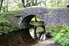 Meavy road bridge. Over the river meavy in Dartmoor national Park, Devon on a bright and sunny day stock photography
