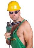 Mecánico con el taladro de mano Foto de archivo libre de regalías
