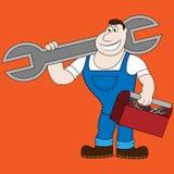 Mecánico de la historieta que sostiene una llave enorme stock de ilustración