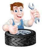 Mecánico del neumático y de la llave inglesa Fotos de archivo
