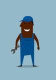Mecánico o reparador sonriente feliz con la llave Foto de archivo