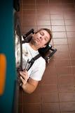 Mecánico que trabaja bajo el coche Imágenes de archivo libres de regalías
