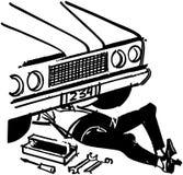 Mecánico Under Car Imagen de archivo libre de regalías