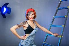 Mecânico da menina com arte da cara no local fotos de stock royalty free