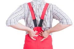 Mecânico que tem a dor nas costas no conceito lombar da área Imagens de Stock Royalty Free