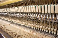 Mecânicos da ação de um piano ereto Foto de Stock