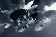 Mecanismo de engrenagem na obscuridade - azul Foto de Stock Royalty Free