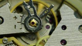 Mecanismo de engrenagens velho do pulso de disparo do cronômetro filme