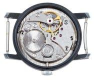 Mecanismo del mecánico del reloj viejo aislado Imágenes de archivo libres de regalías