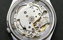 Mecanismo del reloj con los engranajes Fotografía de archivo