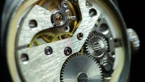 Mecanismo dentro de un reloj viejo Imagen de archivo libre de regalías