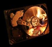 Mecanismo impulsor de disco duro en el fuego fotos de archivo libres de regalías