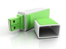Mecanismo impulsor verde del flash del USB en el fondo blanco Fotografía de archivo