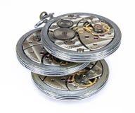 Mecanismo similar del reloj de bolsillo de Thrree viejo aislado Imagen de archivo libre de regalías