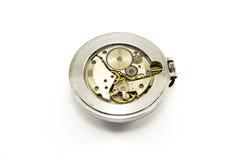 Mecanismo velho do relógio no fundo branco Fotos de Stock