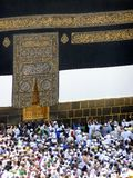 Mecca. In Saudi Arabia, people circulating around the Kaaba, touching the entrance door Royalty Free Stock Photography
