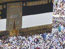 Mecca. In Saudi Arabia, people circulating around the Kaaba, touching the entrance door Stock Image