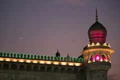 Mecca Masjid Mosque beside charminar, Hyderabad. Scintillating view of Mecca Masjid Mosque near Charminar with crescent moon at night time Telangana, Andhra Stock Photos