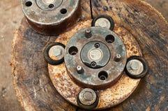 Meccanici arrugginiti d'annata con gli ingranaggi di rame graffiati immagini stock libere da diritti