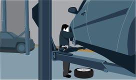 Meccanico che ripara un'automobile Immagine Stock