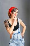 Meccanico della ragazza con arte del fronte Ritratto immagine stock libera da diritti