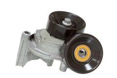 Meccanismo della puleggia di tensionamento con la puleggia di deviazione e di tensione su un bianco Fotografie Stock