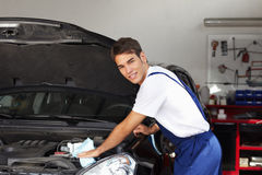 Mechanic. Cleaning car engine and looking at camera stock photos