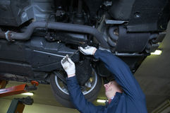 Mechanic. Repairs a car in a garage royalty free stock images