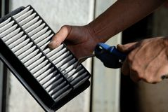 Mechanic. Motor mechanic cleaning the air filter of a car Royalty Free Stock Photography