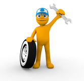 Mechanic. Holding a wrench and tire Stock Image